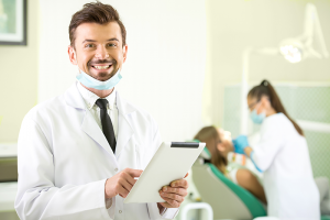 Male Dentist holding his lease agreement