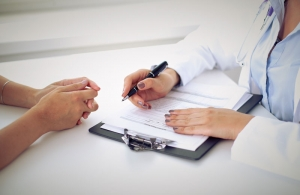 Doctor Signing Her Lease Agreement